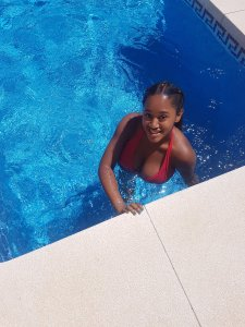Brided hair style with extensions and gold hair clips for the summer. Pool photo
